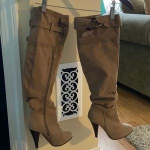Tan knee high heeled boots by Charles Albert